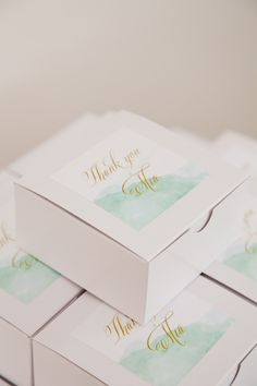 watercolor favor boxes *   {the sweetest occasion -- elegant christening, event design + styling by little sooti, photography by white spark photography, stationery + paper goods by ham & pea}