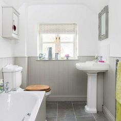 Compact white bathroom with grey panelling The best bathroom design ideas. Create your perfect bathroom whatever your style, budget and room size. Bathroom Paneling, Wood Bathroom, Small Bathroom, Bathroom Ideas, Bathroom Cabinets, Compact Bathroom, Bathroom With Beadboard, Small Cottage Bathrooms, Bathroom Heater