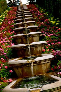 beautiful fountain... Inspires me to want to do something in the back corner of my yard (which makes me remember the waterfall and ponds my dad built in Las Cruces)