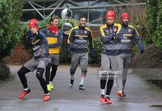 (L-R) Gabriel, Nacho Monreal, Lucas Perez and Francis Coquelin of Arsenal with (R) ex player Robert Pires before a training session at London Colney on January 13, 2017 in St Albans, England.  (Photo by Stuart MacFarlane/Arsenal FC via Getty Images)