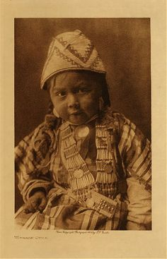1909 Chinook Indian child near Celilo Falls (Columbia River) Wishram village  photo: Edward S. Curtis Native American basketry (basket) hat and beadwork. Oregon and Washington