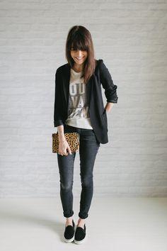 graphic tee + black blazer + black skinnies + slip on sneakers