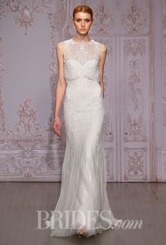 "MONIQUE LHUILLIER - FALL 2015. ""Timeless"" sleeveless silver-and-white embroidered tulle sheath wedding dress with an illusion neckline"