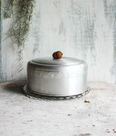 Vintage Aluminum Cake Cover with Acorn/Leaf scroll design and acorn shaped wood handle on Etsy, $20.00
