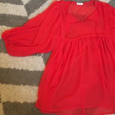 Flowy Sheer Peasant Sleeve Blouse This is a lovely red Everly peasant sleeve blouse that hangs like a dream. Size tag is missing but it's in perfect condition and fits like a medium. Very flattering! Everly Tops Blouses