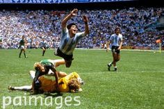 Argentina's Diego Maradona (top) flies through the air after a challenge by West Germany goalkeeper Harald Schumacher (on floor) - World Cup Mexico 1986 - Final - Argentina v West Germany