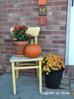 Old chair adds needed height to small front porch display.
