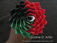 Inspired by the African Flag: Duct tape Rose. This rose does not need water and does not have any thorns :) Can be given to your loved ones for any ocassion. Used as favors etc