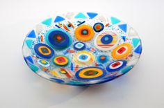 Stacked circles, triangles and strips form this functional and decorative fused glass bowl. Food and dishwasher safe. Each piece is unique and signed by the artist. No two will ever be alike. Set on e