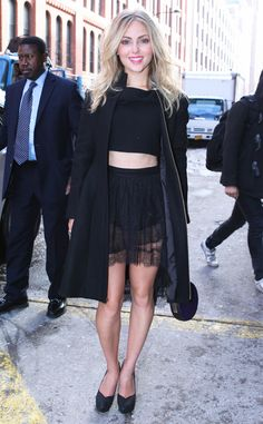 AnnaSophia Robb hits the Houghton show in NYC in the designer's black Tao crop top and Calderon lace mini skirt.