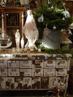 religious figures, potted Christmas tree @Katie Charos reminds me of you. :)