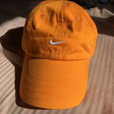a5216ffa bright orange nike hat ! adjustable velcro on back color, a - Depop Sweater  Shop
