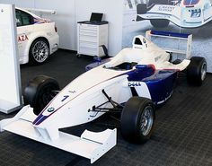 """Formula BMW was what is sometimes referred to as a """"slicks and wings"""" formula, which describes the use ofslick tiresanddownforce-generating wings at the front and rear. The addition of wings results in cornering speeds that are faster than that which is achieved by the winglessFormula Fordcars and comparable toFormula Renault, and provides drivers with valuable first-time experience of the unique characteristics of aerodynamic downforce"""