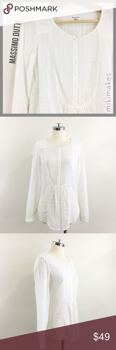 """🆕 MASSIMO DUTTI • vintage white button front top • perfect shirt for your Hamptons get away from Massimo Dutti (higher end sister brand of Zara) • round neck • buttons 1/2 way down the front • bib like detail • long sleeves • size 36 european, which is about a 4 in US size or a small/medium  100% cotton  ✂️  Bust = 38"""" ✂️  Waist = 35"""" ✂️  Shoulder = 15"""" ✂️  Length = 27""""  • sorry no trades • please feel free to ask any questions  ❤️ @mikimakes Massimo Dutti Tops Blouses"""