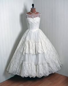 vintage wedding dress. I love this style! Not entirely crazy about the lace doilies in the front though