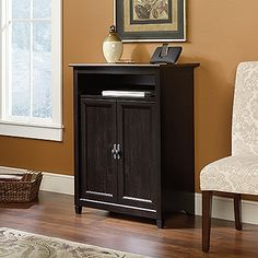 Flip-up panel reveals SmartCenter® charging station with power strip.  Open storage accommodates laptops, tablets, etc.  Hidden storage behind doors features an adjustable, slide-out printer shelf with metal runners and safety stops.  Solid wood accents.  Cord management.  Estate Black finish.