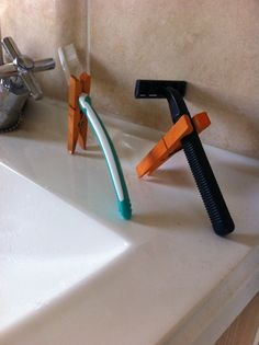 Toothbrush & razor holders from old clothes pegs.