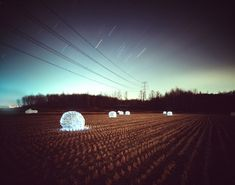 Gorgeous 'Starry Night' light installations by Photographer Lee Eunyeol. The installations are made to appear as if the sky has been flipped upside down onto the ground, creating beautiful glowing landscapes. The various colored lights resting on the earth's cracks or lying between tall blades of grass represent glimmering stars and planets. via colossal