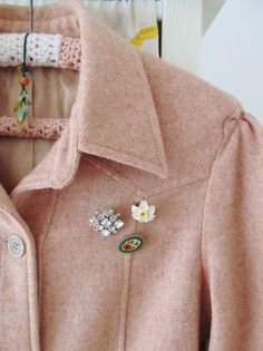 A sweet cluster of vintage broaches on the breast of your winter woolens makes a darling embellishment.