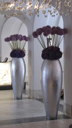 .Tall, simple but elegant, delightful purple and silver combination.