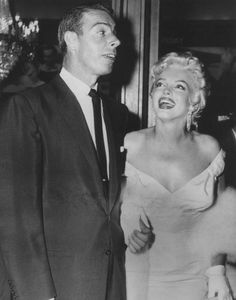 June 1, 1955: Marilyn Monroe and Joe Dimaggio at the premiere of The Seven Year Itch, held at the Loew's State Theatre in Times Square, New York.