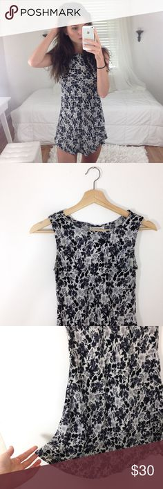 Curved Hem Tunic Adorable black white and grey floral curved hem tunic / dress, size small / extra small. Not listed brand. I'm 5'8 and I wear shorts underneath! Vintage tag Missguided Tops Tunics