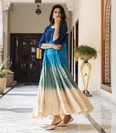 Set the level of gorgeousness with the latest collection of Indian wear from @aksbynidhi available on Myntra. Find this navy blue & green ombre dyed anarkali kurta on your Myntra app with code 7094497 priced at Rs. 1799/- #Myntra #IndianWear #AksByNidhi #WomenWear #WomenFashion