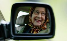 Queen in wing mirror -The Queen has been a driver for more than 70 years CREDIT: GETTY