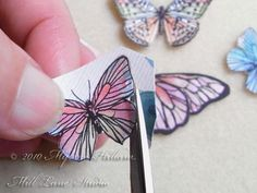 Cut out all the butterflies from the scrapbook paper carefully and then coat them with a layer of epoxy resin. Tutorial by Myléne Hillam of Mill Lane Studio.