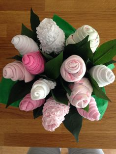 A baby bouquet, made with socks, bibs, t-shirts, sleepsuits, mittens xfx