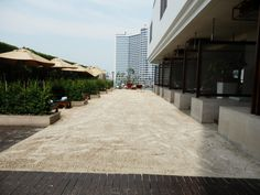 The Beach area poolside at the Millennium Hilton Hotel in Bangkok, Thailand