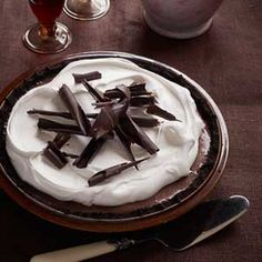 Just before serving, this chocolatey pie gets garnished with sweet whipped cream and luxurious chocolate curls. Get the recipe!  - GoodHousekeeping.com