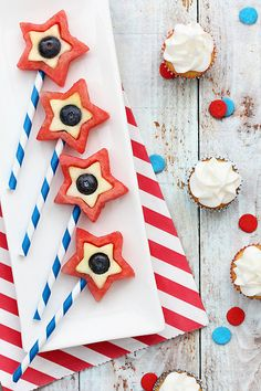 Cookie cutters turn watermelon, apples, and blueberries into a healthful holiday dessert. Striped straws add to the appeal. Source: Bakers Royale
