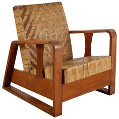 French Modernist Teak and Cane Lounge Chair, 1930s   From a unique collection of antique and modern lounge chairs at https://www.1stdibs.com/furniture/seating/lounge-chairs/