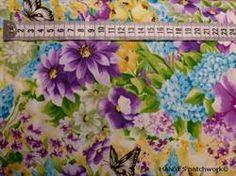Friske blomster på Patchworkstof - blomst- er et super flot blomstret patchworkstof