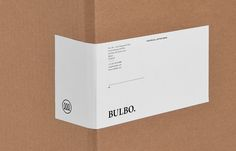 Logo and box sticker for high-end boutique lighting shop and interior planning service Bulbo designed by Anagrama
