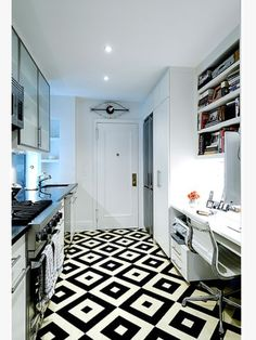 The classic black and white combo is one that works well, especially in this striking design. Just shows you the impact a good floor can have on the interior design of a room.