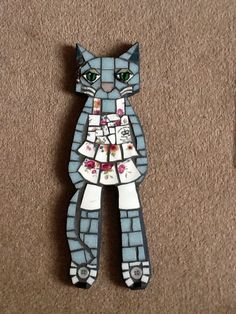 Blue cat mosaic with china plate dress.