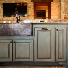 Outdoor Kitchen- The cabinets and sink are beautiful!!