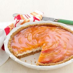 Sunny Peaches & Cream Pie Recipe -I've always thought this pie was as delicious as it is beautiful. It's not just a summer dessert, either. I also make it for the holidays, using strawberries and strawberry gelatin. —Lorraine Wright, Grand Forks, British Columbia