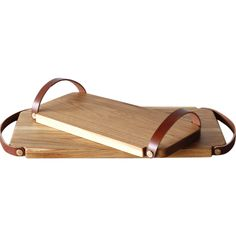 Handcrafted in a small shop in Pennsylvania, this white oak tray has vegetable tanned leather handle and...