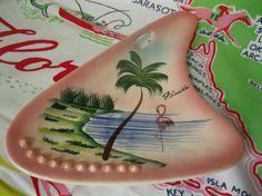 Cool vintage 1950s pink boomerang Florida souvenir ashtray from 3floridagirls!!  http://www.etsy.com/listing/95688689/cool-1950s-pink-boomerang-florida