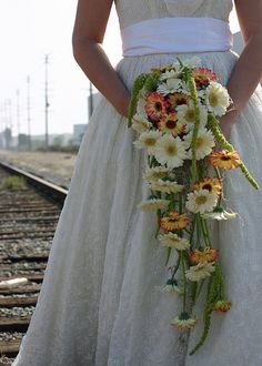Google Image Result for http://static.w-weddingflowers.com/wwflower/2011/01/hawaiian-flowers-wedding.jpg.....  Lets make this navy and yellow.. love it!