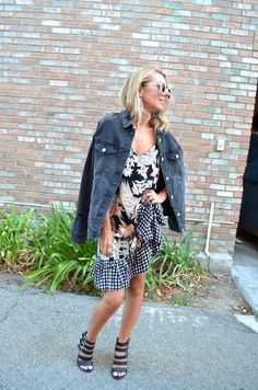 Transitioning to Fall with a Denim Jacket - Jaclyn De Leon Style + casual street style + mixed print dress with gingham print ruffle hem + distressed girlfriend jean jacket + fall outfit inspiration + what to wear for fall + jacket over a summer dress