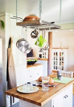 tiny& narrow butcher block with hanging pots (fixture from ikea)