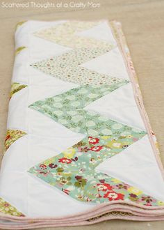 Make a chevron quilt the easy way! = This one does use half-square triangles.
