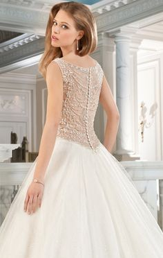 Tying the Knot Bridal Boutique - Designer Style Dresses