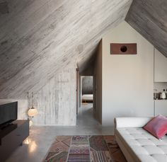 When Fernanda Gramaxo bought the derelict 19th-century iron warehouse in Porto's old Largo de São Domingos quarter, she had the unshakeable notion that beneath the crumbling masonry was a hotel in the rough. Three years later, the Armazém (Portuguese f...