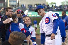 A young fan takes a selfie with Anthony Rizzo before the Cubs game,