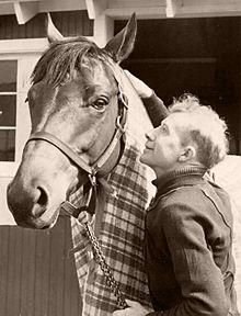Seabiscuit, grandson of Man O'War, with Red Pollard